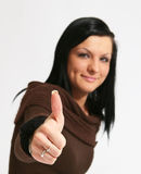 Thumbs up. Attractive caucasian girl showing thumbs up with happy smiling facial expression. Image isolated on white background Royalty Free Stock Image