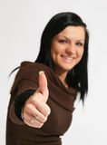 Thumbs up. Attractive caucasian girl showing thumbs up with happy smiling facial expression. Image isolated on white background Royalty Free Stock Images