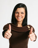 Thumbs up. Attractive caucasian girl showing thumbs up with happy smiling facial expression. Image isolated on white background Stock Photography