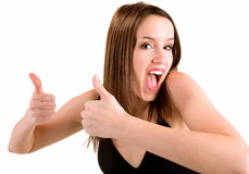 Thumbs Up. A beautiful brunette is showing her appreciation towards a job very well done Royalty Free Stock Photography