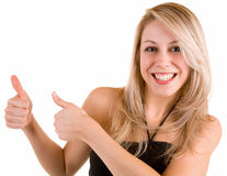 Thumbs Up. A beautiful blonde is showing her appreciation towards a job very well done Royalty Free Stock Photos