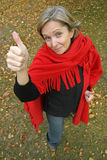 Thumbs Up. A middle aged woman showing thumbs up gesture Stock Photography