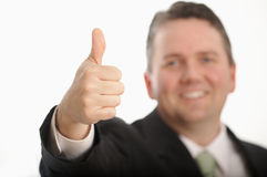 Thumbs up. Man giving thumbs up, DOF focus on hand Royalty Free Stock Image