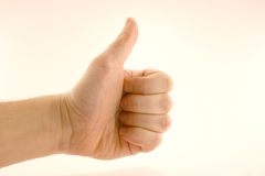 Thumbs up. A thumbs up on white background Royalty Free Stock Photography