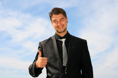 Thumbs up. Business man showing okay sign Stock Image