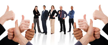 Thumbs Up!. Business people with their thumbs up in support Stock Image