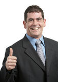 Thumbs up. Happy businessman giving thumbs up on white Stock Photography