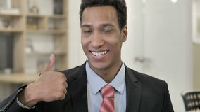 Thumbs Up by African Businessman. 4k high quality, 4k high quality stock footage