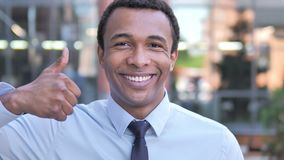 Thumbs Up by African Businessman, Outdoor. 4k high quality, 4k high quality stock video footage