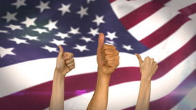 Thumbs up against american flag. Digital composite Thumbs up against american flag stock video