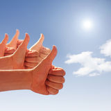Thumbs up on background of blue sky Stock Photography