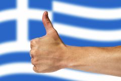 Thumbs up on a background of a flag of Greece.  stock photography