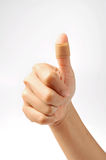 Thumbs up with bandage Royalty Free Stock Image