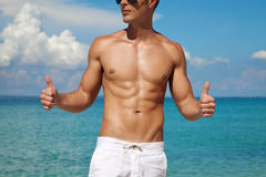 Thumbs up for a beach body Royalty Free Stock Image