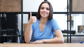 Thumbs Up By Beautiful Brunette Woman, Indoor Royalty Free Stock Photos