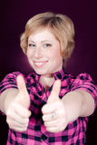 Thumbs up by Beautiful happy smiling young woman Royalty Free Stock Photos