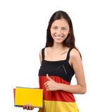 Thumbs up. Beautiful student with Germany flag blouse holding books. Stock Image