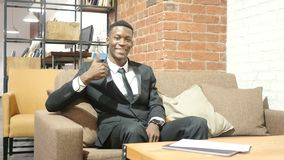 Thumbs Up By Black Businessman. Beautiful interior stock video footage