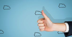 Thumbs up blue background with clouds Royalty Free Stock Photography
