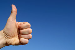 Thumbs up with blue sky. Stock Image