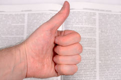 Thumbs up and book. Stock Photography
