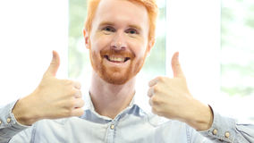 Thumbs up by Both Hands, Successful Positive Red Hair Beard Man Stock Photo