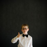 Thumbs up boy dressed up as business man Stock Images
