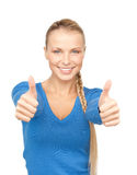 Thumbs up. Bright picture of lovely teenage girl with thumbs up Stock Photography
