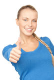 Thumbs up. Bright picture of lovely teenage girl with thumbs up Royalty Free Stock Photos