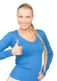 Thumbs up. Bright picture of lovely teenage girl with thumbs up Stock Images