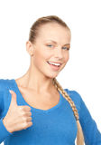 Thumbs up. Bright picture of lovely teenage girl with thumbs up Stock Image