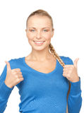 Thumbs up. Bright picture of lovely teenage girl with thumbs up Stock Photo