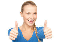 Thumbs up. Bright picture of lovely teenage girl with thumbs up Royalty Free Stock Image