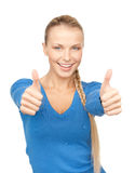 Thumbs up. Bright picture of lovely teenage girl with thumbs up Royalty Free Stock Photography