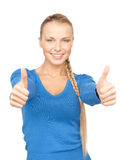 Thumbs up. Bright picture of lovely teenage girl with thumbs up Stock Photos