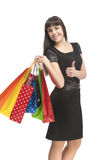 Thumbs Up of Brunette Woman with Bags Stock Photo
