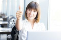 Thumbs up from business woman stock photography
