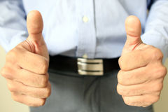 Thumbs up businessman. success in the office Stock Image
