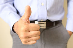 Thumbs up businessman. success in the office Royalty Free Stock Photo