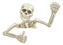 Thumbs Up Cartoon Halloween Skeleton. A skeleton Halloween cartoon character peeping over a sign waving and giving a thumbs up vector illustration