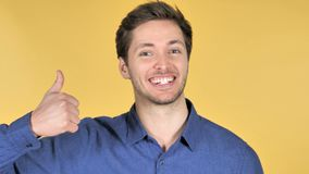 Thumbs Up by Casual Young Man on Yellow Background stock footage
