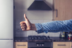 Thumbs up in clean and tidy kitchen Stock Images