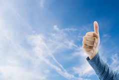 thumbs up on cloudy sky in the background Royalty Free Stock Image