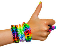 Thumbs up for colorful rainbow loom rubber bands bracelet. stock photos