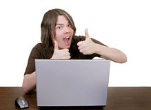 Thumbs up with computer. Young guy fixing computer makes it better Royalty Free Stock Images