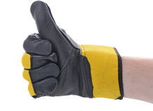 Thumbs up construction glove. Symbol of ok thumbs up wearing a saftey glove for construction work Stock Image
