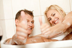 Thumbs up coulpe bathing. Smiling young couple showing thumbs up Royalty Free Stock Images