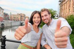 Thumbs up couple happy in Stockholm, Sweden Stock Photo