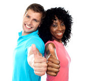 Thumbs up couple in love. Keep rocking Stock Images