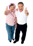 Thumbs-up couple tuned into music Stock Image